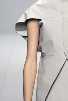 Fashion Minimalism - line & angle - dress with clean, contemporary silhouette; closeup fashion details // Rick Owens