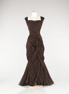 This dress may work for the Xmas ball as well, in deep green or blue