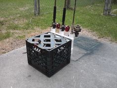 of brown plastic lattice, painted it, and attached it with pieces of bungee cord - securement is with the loop of bungee on the crate, and the plastic . Kayak Fishing Gear, Fishing Cart, Fishing Stuff, Canoe Boat, Canoe And Kayak, Kayak Rod Holder, Rod Holders, Kayak Crate, Plastic Lattice