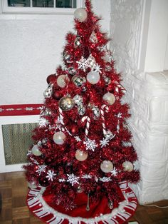 I love this red christmas tree. I have never seen one before. it would be so cool with some lights on it.