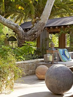 Front Exterior of Sela Ward's home -- A bridge over the property's creek leads to the home's  front door. So cool!! Large decorative spheres artistically punctuate the space.