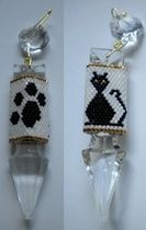 """Cat Paw Crystal Drop by Hope Designs Proceeds from this sale will go to Project Hope, a no-kill animal shelter in Metropolis, IL.  This pattern was created for use with the 3"""" crystal drop available at Sova-Enterprises.com, model #178. Using only 3 colors, it makes up pretty fast! Includes graph, suggested beads and amounts, and color photo. Stitch: Peyote  Beads Used: 11/0 Delicas  Approx Finished Size: 1.27"""" x 1.96""""  Pages to Print: 3"""