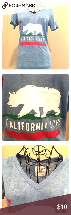 NWT California Love Tshirt NWT REAL CUTE denim color with California bear and colors. Nice and light weight. V neck. Great for jeans or throw a blazer over it. Great T. HAND CRAFTED wooded necklace in last photo sold separately reflex Tops Tees - Short Sleeve