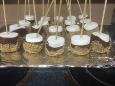 S'mores on a stick. Giant marshmallows dipped in choc and graham cracker crumbs. Very easy !