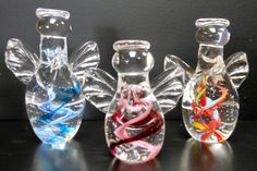 Glass angel sculptures by James Hayes...custom colors and inscription available to give a personal touch to these wonderful gift items!!