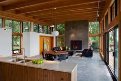 Living Area and Fireplace in NW Modern New Home @ http://hammerandhand.com/