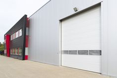 Overhead door company of fargo your fargo garage door expert Exterior Signage, Exterior Design, Factory Architecture, Barn Shop, Warehouse Design, Industrial Architecture, Factory Design, Building Exterior, Metal Buildings
