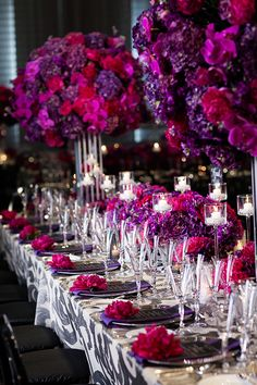 Vibrant Purple and Fuchsia Floral Arrangements with Modern Patterned Linens | Arrowood Photography
