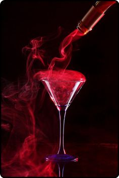 Smoky red martini on black background