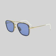 Thom Browne sunglasses in blue with 18 carat gold frame.  Thomebrowne