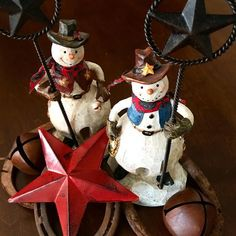 Adorable cowboy snowmen candle holders help light up the holidays