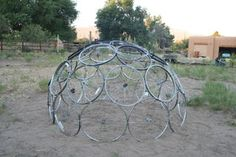Make a dome out of old bike rims then plant climbing nasturtiums or clematis and imagine how beautiful this would look by mid summer?!