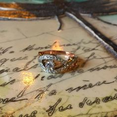 white and rose gold diamond ring on Sid Dickens' Transformation memory block