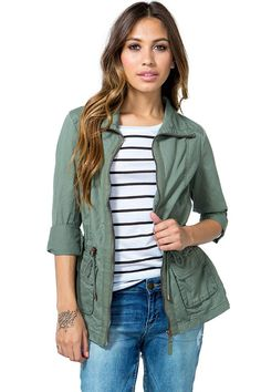 A versatile anorak jacket featuring a wide collar and a full zip closure. Drawstring waist with a bungee cord puller. Side flap pockets. Long sleeves. Finished hem. Lightweight. $34.50