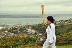 The Olympic torch above Portland Harbour. Photo by Pete Allan.
