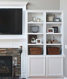 take bookshelves, fit into place as best can, add molding...custom built-ins...