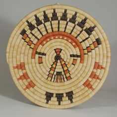 "Adobe Gallery - Hopi 2nd Mesa Coiled Basket with Katsina Image. Category: Trays and Plaques Origin: Hopi Pueblo Medium: galleta grass, yucca leaves Size: 1-1/2"" deep x 12-1/2"" diameter Item # C3736P"