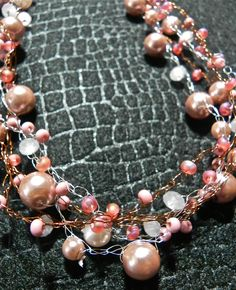 Rose Colored Glasses is made of glass beads and glass pearls on crocheted wire in silver and copper.  $58.00