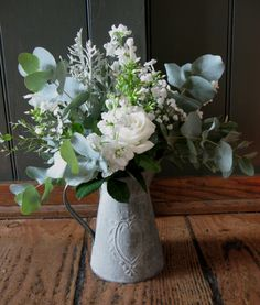 Rustic metal jugs, complemented the white and silver theme at Priston Mill.