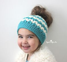 I'm sure many of you have seen the latest crochet trend: Messy Bun Hats! Also known as pony tail hat, these beanies have a hole at the top for your hair to hang through. A fun and functional look! Love Crochet, Crochet For Kids, Crochet Beanie, Crochet Hats, Crochet Dresses, Crochet Poncho, Bernat Super Value Yarn, Beanie Pattern, Crochet Patterns