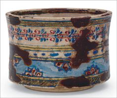 "Ember pot in ""Dutch"" style, by Ogata Kenzan (1663– 1743), Narutaki workshop, 1699–1712, Japan, Edo period. 9.3 x 13.3 cm. Courtesy Freer Gallery of Art, Smithsonian Institution; gift of Charles Lang Freer."