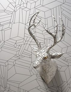 """""""Wookjae Maeng is a Korean artist who works with ceramics, focusing on the relationships between man and animal. The ghostly pieces often resemble commemorative busts or mounted heads reminiscent of big game trophies (the kind you'd seen in a hunter's den). Sometimes, works are painted to blend in with wall treatments or trendy decor."""""""