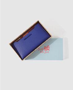 Cartera azul y naranja Colección Navidad de Jo & Mr. Joe con trece tarjeteros