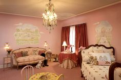 French Inspired girls room. French provincial sofa and bed , crystal lamps and chandelier, drapery and murals