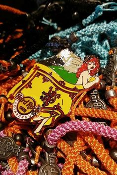 Our exclusive Flag Girl pin featuring the Lion Rampant #pincollectors #thisishardrock #redhead #flag
