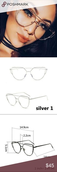 Neiman Marcus Fashion Glasses Cat  Eye  Clear Lens, Silver, Metal Eyeglasses. Has a light UV lens. Worn 1x. Neiman Marcus Accessories Glasses