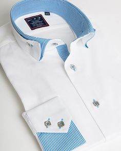 Elegant white dress shirt, Unique reverse collar with turquoise matching tone, Exclusive V-Notched cuff design with two square buttons, Turquoise vichy contrasting details, Metallic squared buttons, Turquoise buttons stitching, Design in Paris, France, Shipping from USA.