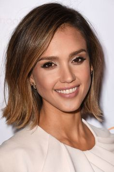 Who: Jessica Alba What: Shades of Bronze How-To: Alba played up her features, framed gorgeously by her new bob, with pretty shades of bronze, gold and brown. Keep the look feeling multi-dimensional by sticking to matte finishes on the skin and cheekbones, light-reflecting ones on the lips and lids and an outline of black pencil around the eyes. Editor's Pick: AERIN Weekend Palette, $70, neimanmarcus.com.