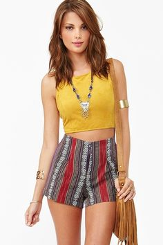 Mustard colored sleeveless crop top and ethnic printed shorts