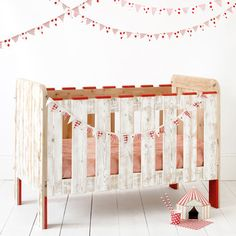 gorgeous crib handmade by three brothers in Spain