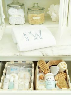 """This is a photo from a bathroom I did for a client, and how we helped them organize their drawers. In this pull-out one I packed """"ready to go"""" travel bags, all under 3oz containers - just grab and go."""