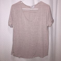 Bar III v-neck shirt This is a basic V-neck shirt that has stitched sleeves to give it a loose cuff. It's a hard color to describe its like a tan/mauve/gray color. Comes in a size small. Bar III Tops Tees - Short Sleeve
