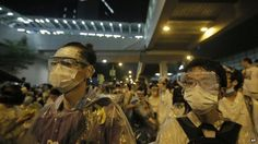 Protesters wearing masks and goggles gather outside the government headquarter in Hong Kong, on 28 September 2014.