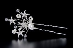 The perfect beach wedding hair accessory is designed with rhinestone jeweled starfish, crystal beads and freshwater cultured pearls. Length of the entire pin is