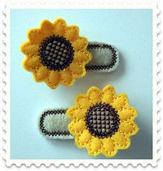 Sunny sunflower clips. Machine embroidered felt hair clips, attached to alligator clips.