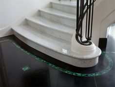 Stairs of Carrara marble leap from black granite floors inlaid with semiprecious malachite stone. http://fdluxe.dallasnews.com/2013/04/the-envy-of-empresses-everywhere.html/