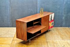 """USA, c.1950s. Vintage George Nelson Herman Miller """"Thin Edge"""" Walnut Hi-Fi Stereo Cabinet/Credenza. With Sven Markelius Pythagoras Fabric Speaker Cover. Sliding Door, Record Cabinets, and Drop Down Door to Reveal Turntable and Storage Shelf."""