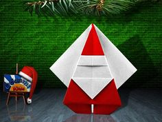 Santa Claus by Katsushi Nosho  Folder and Photographer: Origa MiKids  Difficulty level: Easy. Time to fold 10 min. 13 steps. One square origami Red and White piece of paper about 20cm x 20cm.  Diagrams in Origami de Christmas 2 by NOA (Nippon Origami Association) Pages 9-10  How to fold: http://origami-blog.origami-kids.com/origami-santa-claus-by-katsushi-nosho.htm