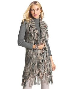 """Make this fringe vest one of your latest style obsessions. The soft, multicolored knit and lush fringe take lavish texture to a new level.   Regular length: 35"""". Petite length: 31.5"""". Acrylic, wool.  Machine wash. Imported."""