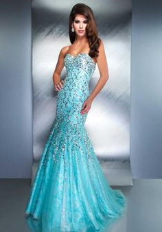 MacDuggal Couture Dress 85144D at Peaches Boutique long blue mermaid prom dress with silver accents