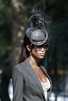 Naomi Campbell arrives at the Horse Guards Chapel in central London, 18 September 2007, wearing a Philip Treacy hat.