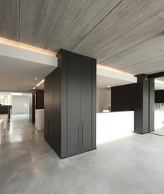 Hidden cupboards by Graux & Bayens. Nice #office space. #blackandwhite #concrete
