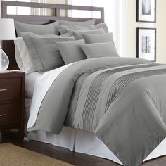 Outfit your master suite or guest room in sophisticated style with this cotton duvet cover set, showcasing a tuxedo-pleated design and platinum hue.
