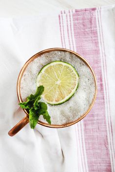 Frozen Mule, serves one.  2 ouncesHangar 1 Straight Vodka ginger beer lime  Blend together two ounces vodka, a can of ginger beer, juice of half a lime and a few handfuls of ice to make this super yummy treat! Garnish with a lime slice and a bit of fresh mint.