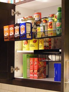 Rubbermaid pull down racks (big enough for 14 oz cans, not 28 oz though) for efficient kitchen storage @Hayley Sheldon Frink