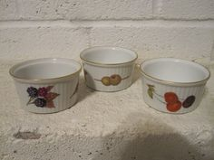 Three Royal Worcester Evesham pattern gold rim ramekins. - $15    This nice collection of three Royal Worcester Evesham Gold Ramekin show little signs of use and have no chips, cracks or restoration.     This wonderfully charming and very collectible pattern from the Royal Worcester porcelain factory is a nice addition to any collection.     These Ramekins have a diameter of 3.25 inches.    All Inquiries    or     clientservices@dejavuantiquesandcollectables.com